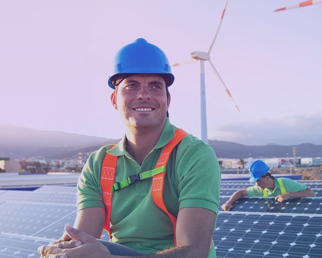 Image of a solar panel worker that recently gained employment after working through his city's workforce development department.